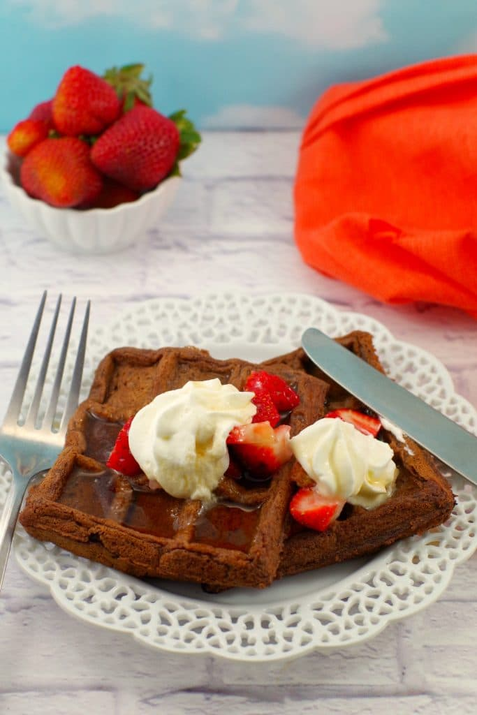 Belgian Chocolate Waffles with whipped cream and strawberries