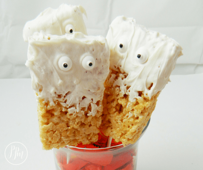 Food is more fun on stick, am I right? These Halloween Rice Krispie Ghost Treats are so fun to make and eat. Plus, they're easy to whip up!