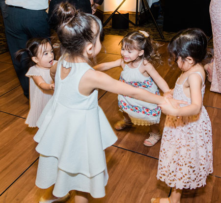 little girls dancing at birthday party