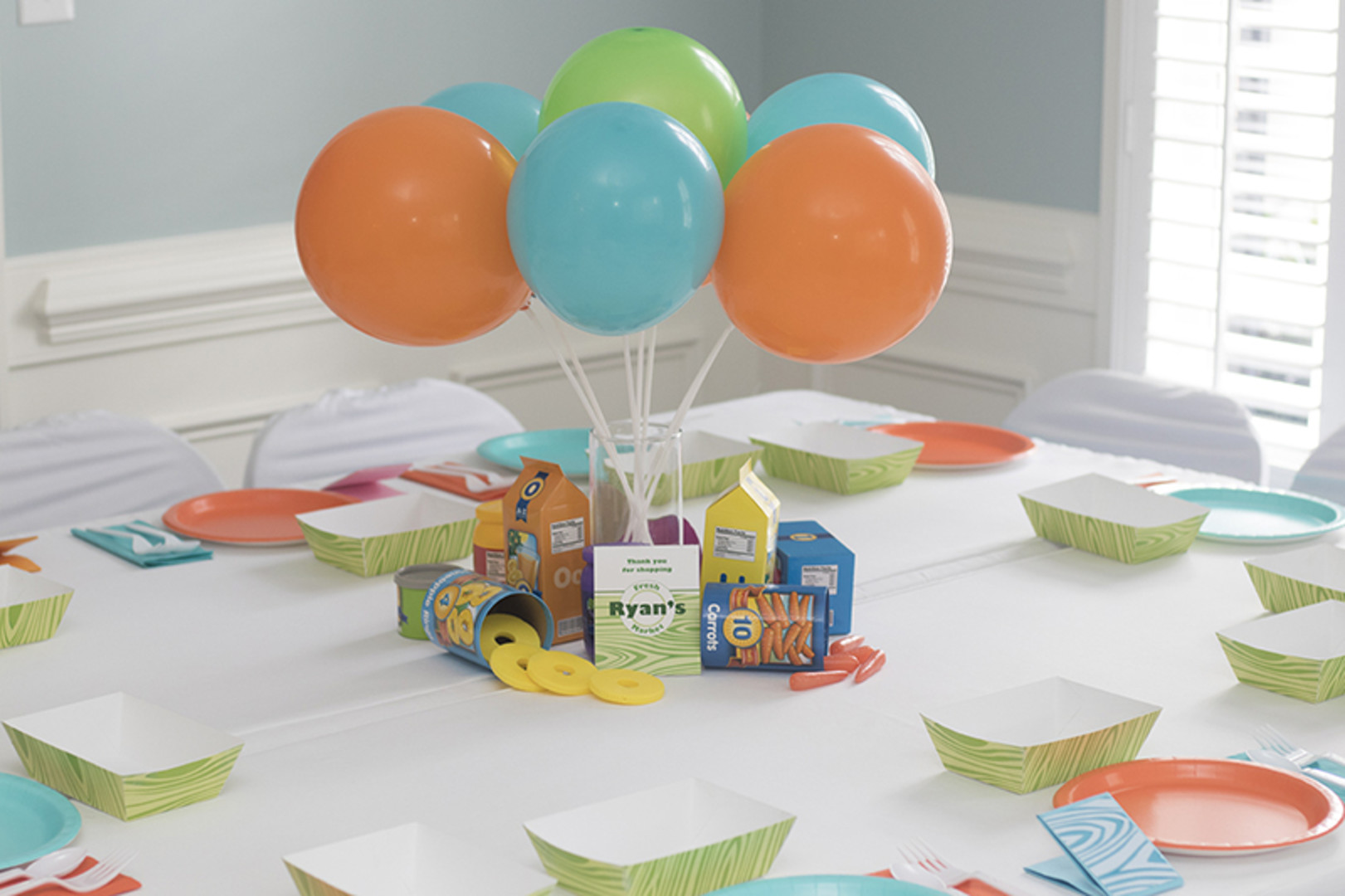 balloon centerpiece for grocery store themed first birthday party