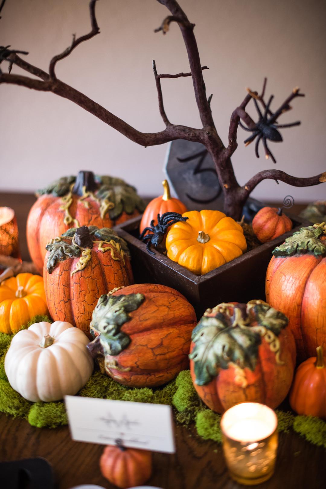 Halloween centerpiece with pumpkins, spiders and gravestone marker
