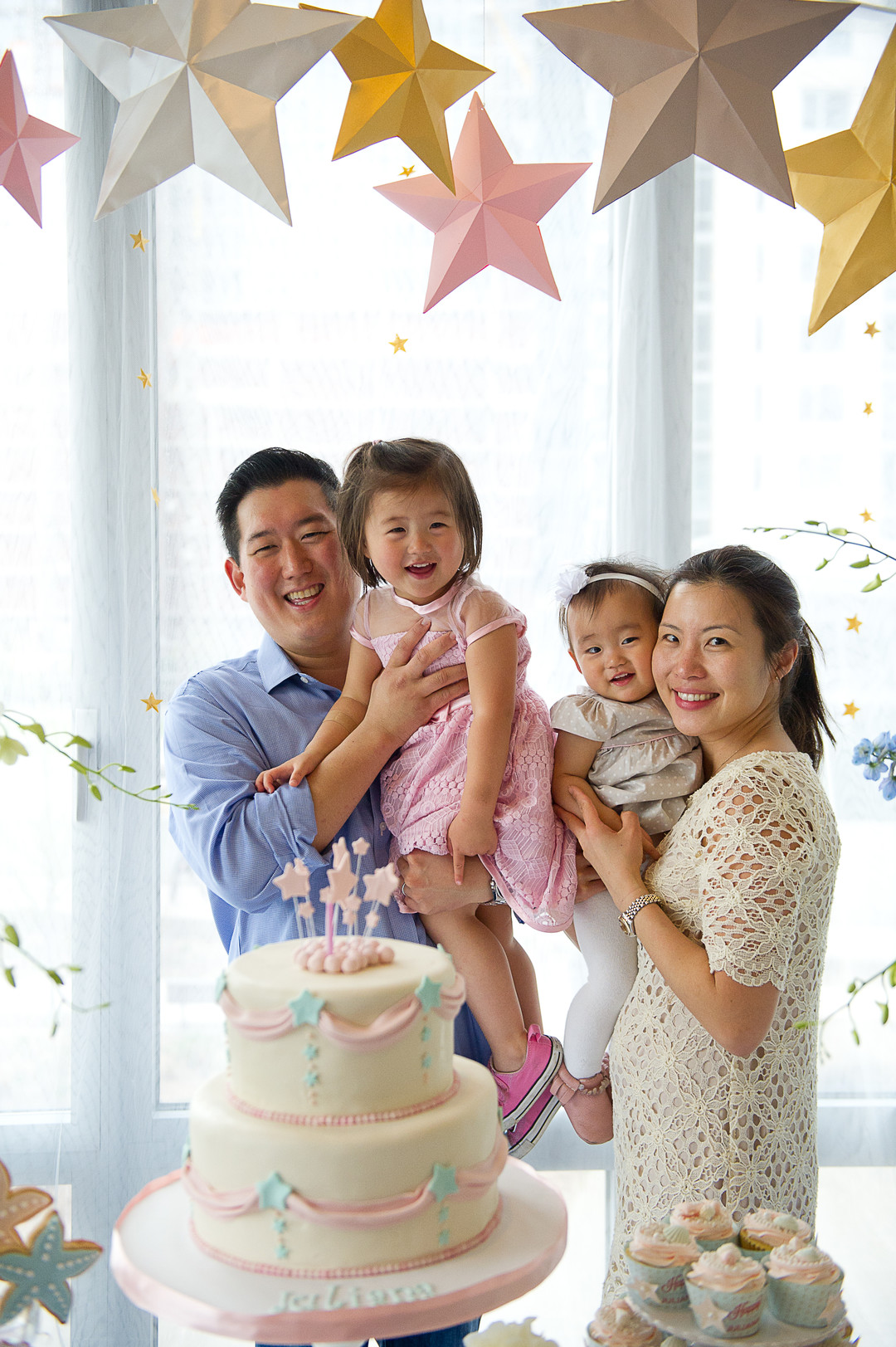 family celebrating daughter's first birthday party