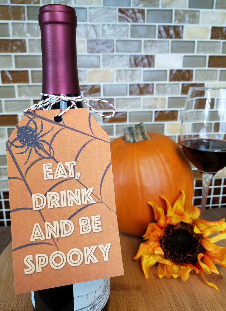 Do you need an easy DIY wine tag for a last minute Halloween Hostess Gift? We've got you covered with these downloadable Halloween Wine Tag Printables! Check out these funny wine tags for the perfect option! #Halloween #winetag #hostessgift #DIY #printable