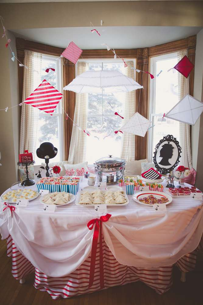 Mary Poppins themed dessert table with umbrellas and kites