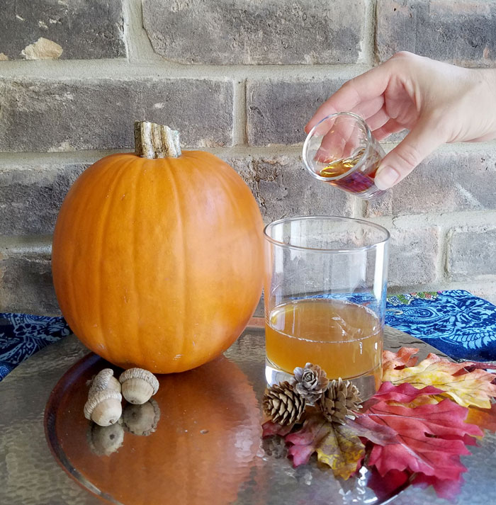 adding maple syrup to maple old fashioned cocktail recipe for fall