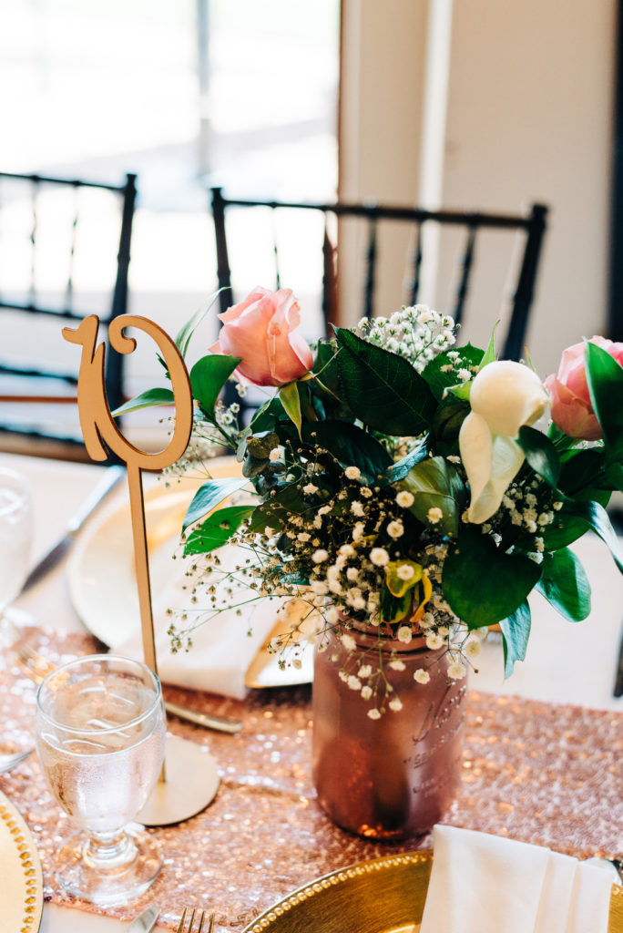 flowers in rose gold mason jar on table top at birthday party