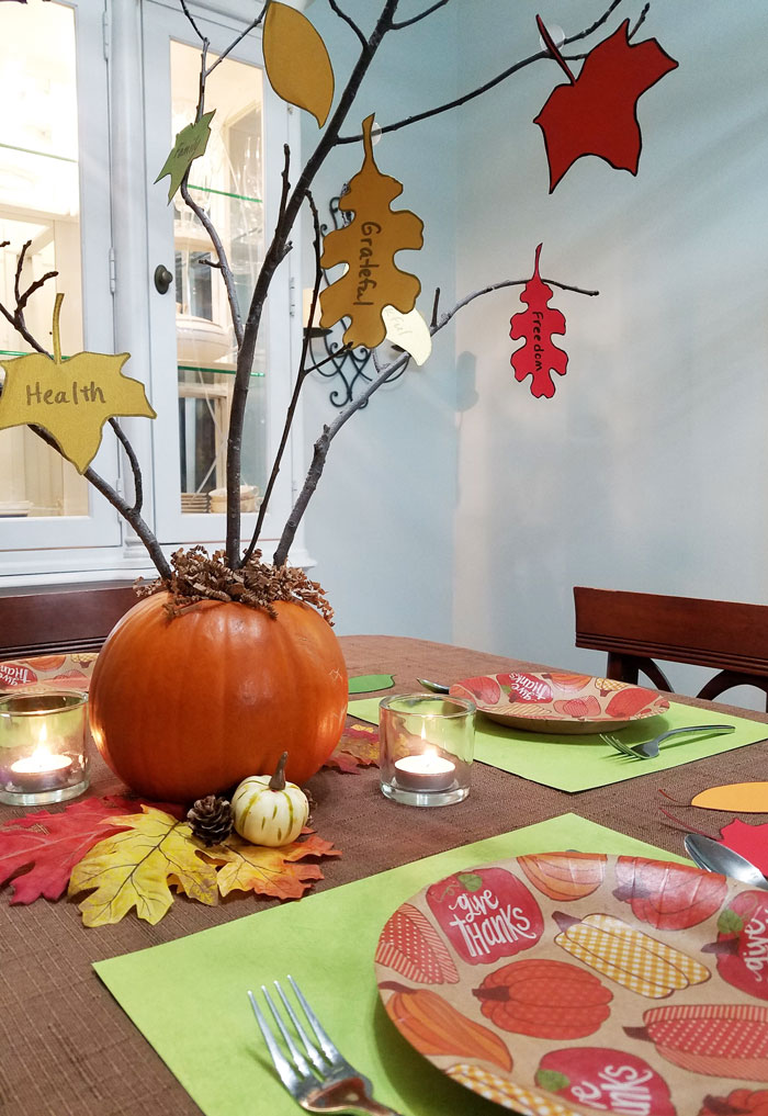 Thanksgiving centerpiece with gratitude tree and printable fall leaves