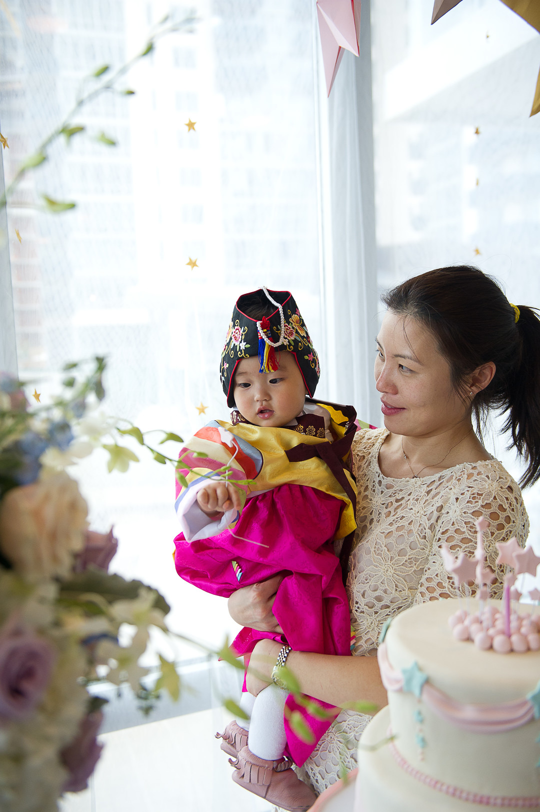 first birthday girl and her mother in traditional korean outfit