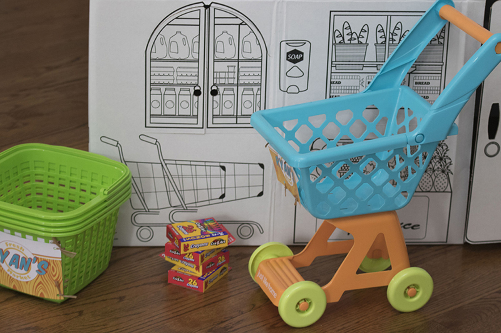 grocery store cart and basket toys at birthday party