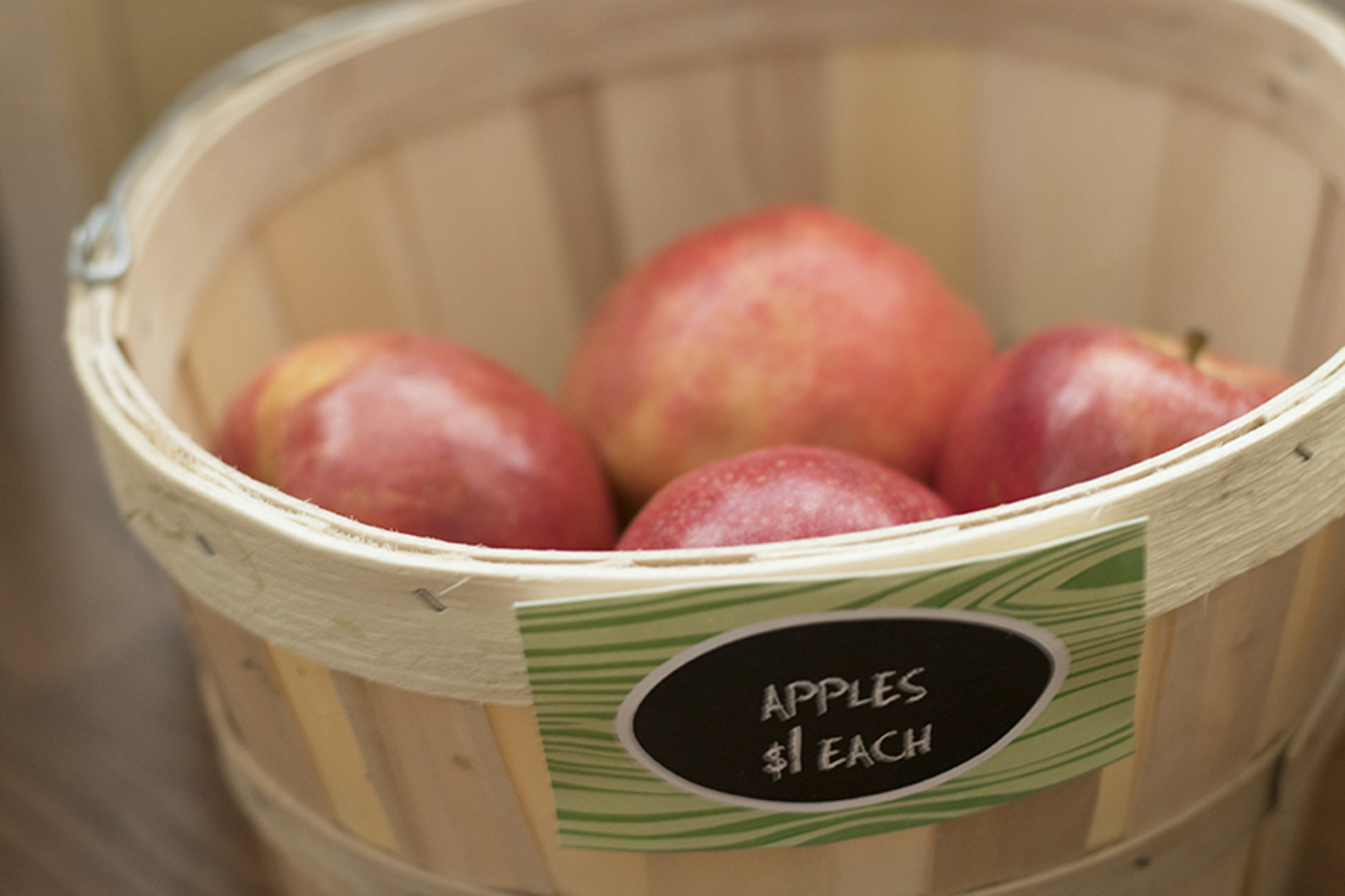 apples in basket at grocery store themed first birthday party