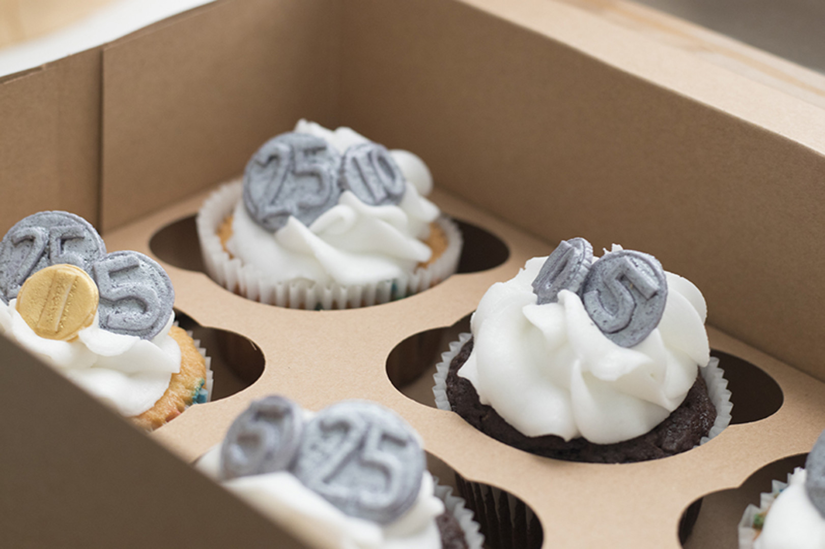 cupcakes with coins on top for grocery store birthday party