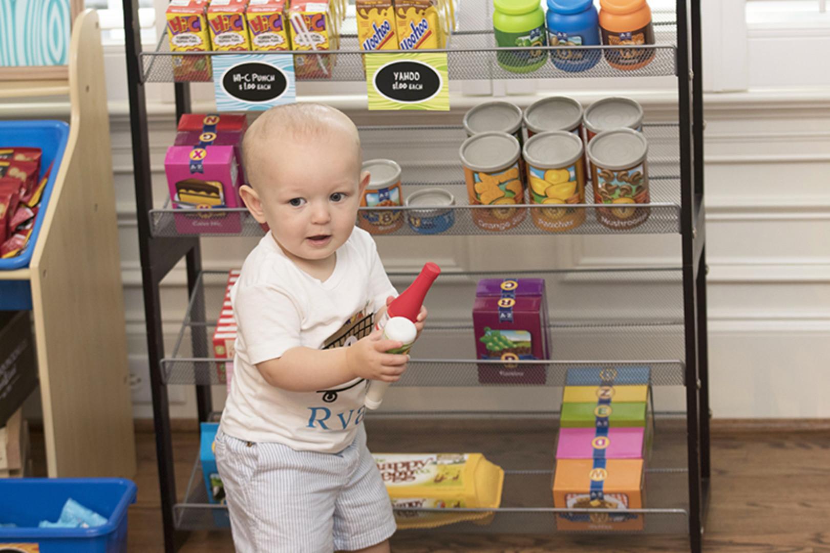 first birthday grocery store birthday party with birthday boy