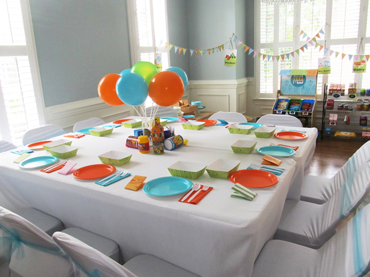 first birthday party table decorations in blue orange and green