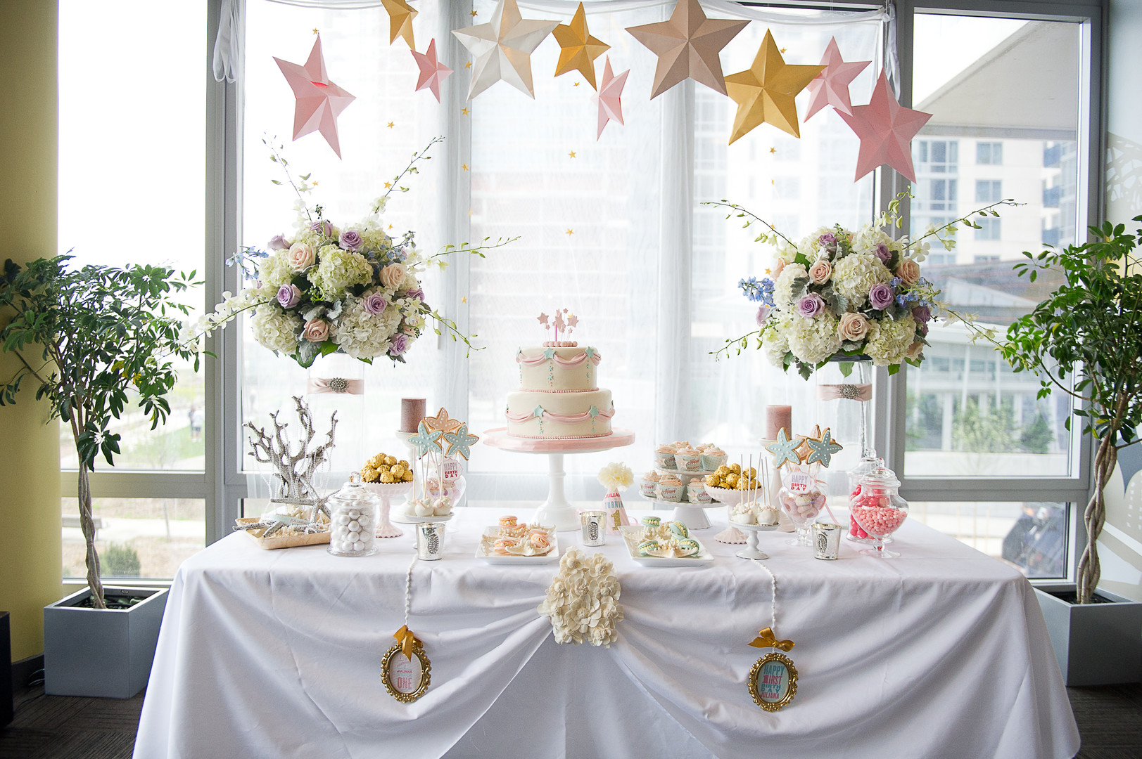 stars and pearls themed first birthday party dessert table