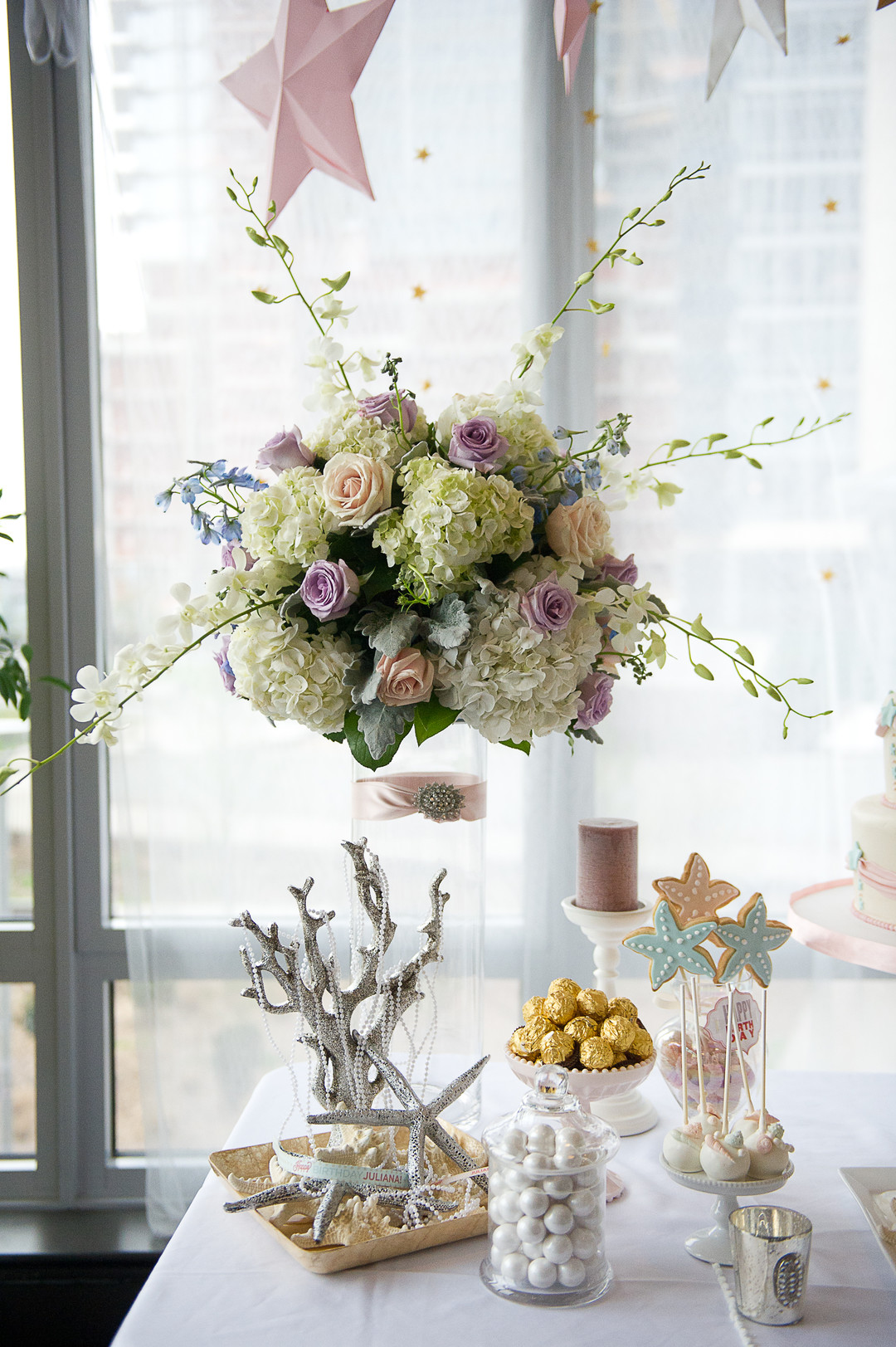 floating floral arrangement with hydrangeas at first birthday party