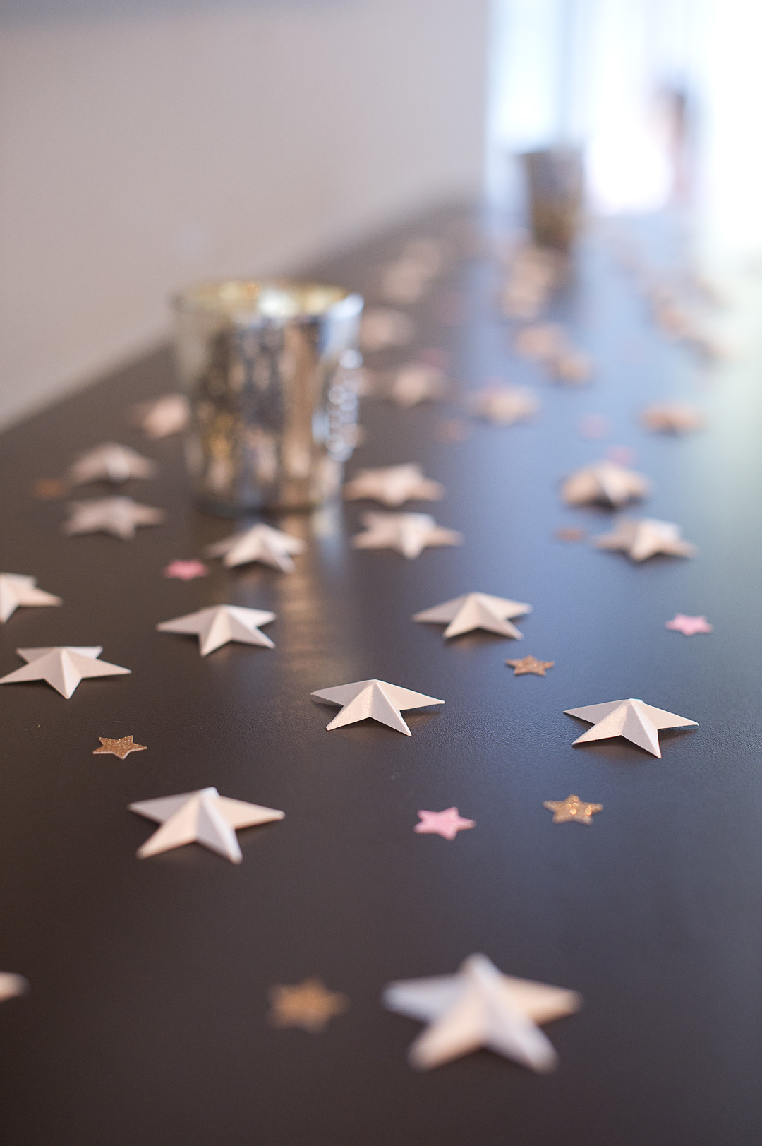 paper confetti stars on dark table