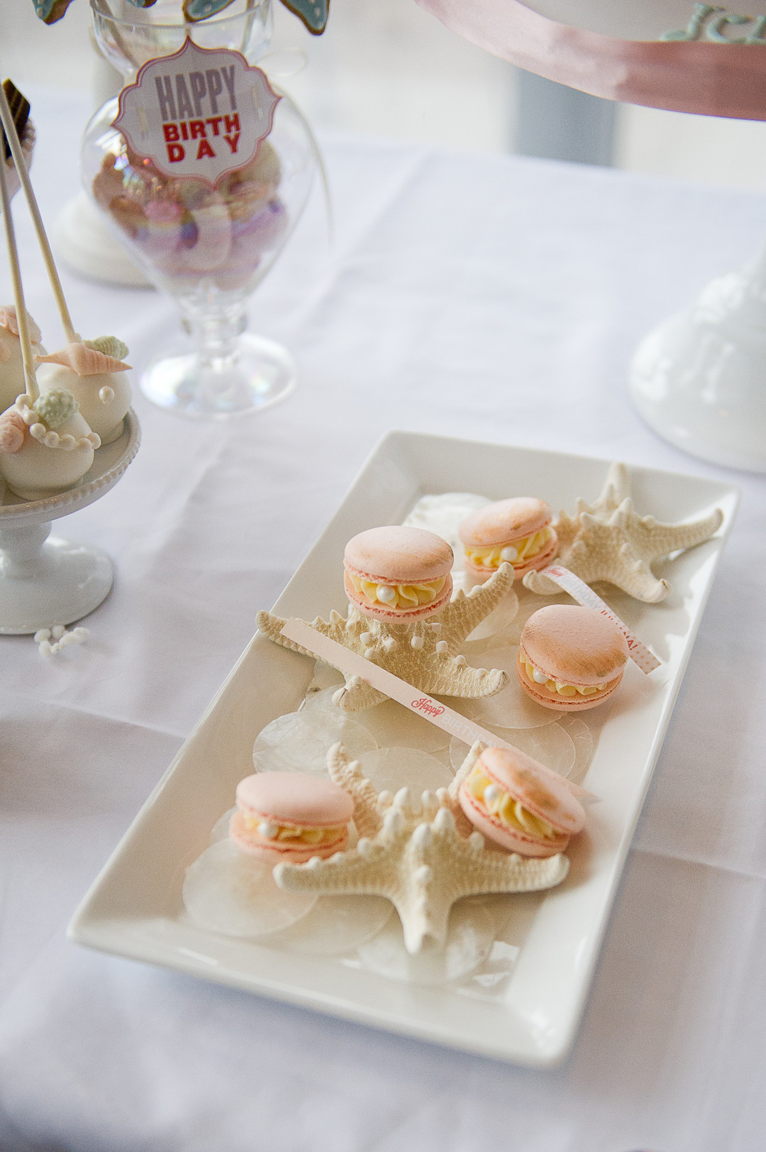 pink macarons with pearls and starfish
