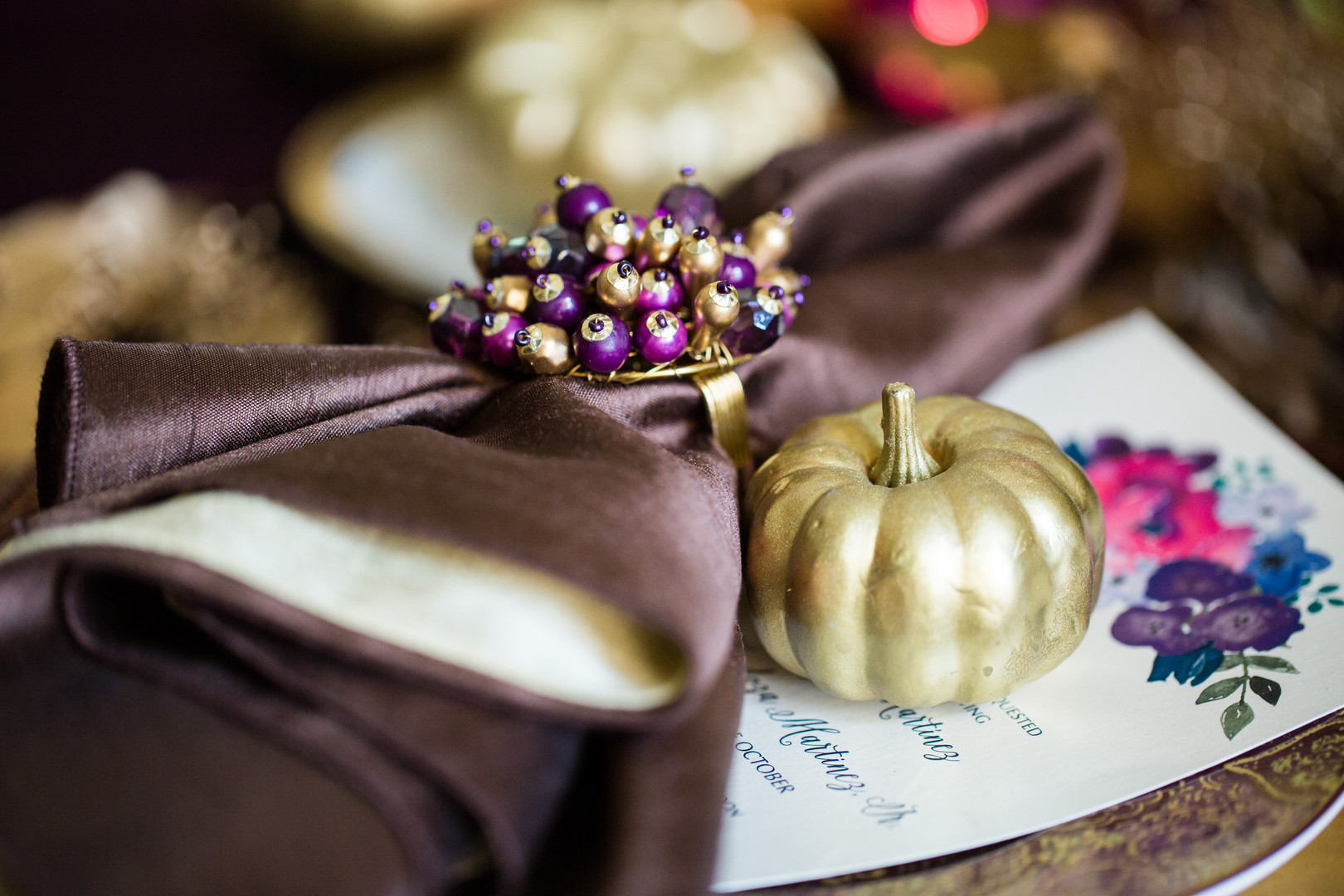 Looking for ideas for centerpieces, tablescapes and place cards for your Thanksgiving table? This elegant jewel toned rustic Thanksgiving tablescape is something you could recreate at home! Check out all the decorations and photos when you click here. #Thanksgiving #Thanksgivingtable #holidaydecor #parties365