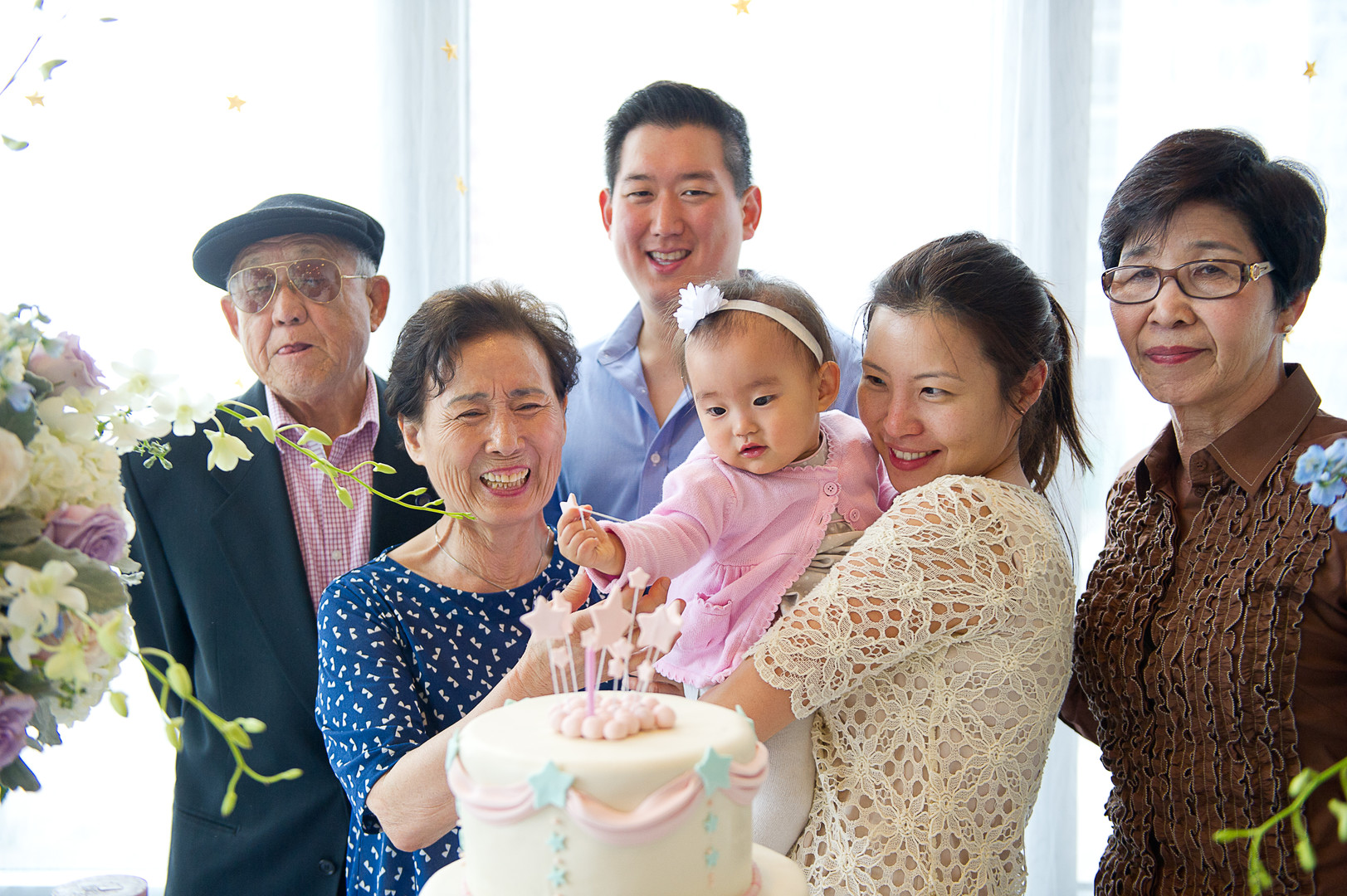 family celebrating girl's first birthday