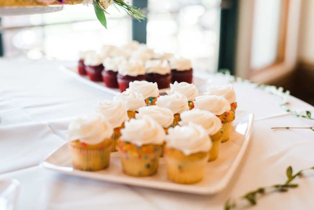 mini cupcakes on white trays at graduation party