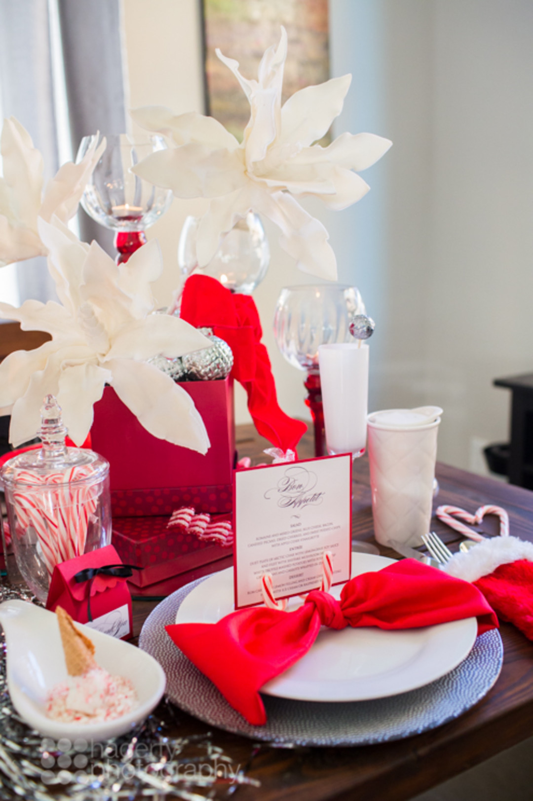 Looking for simple Christmas tablescape ideas for your holiday table? This elegant red, white and silver candy cane table setting has a lovely centerpiece and would be the perfect table decoration for your party or dinner! Click for all the details! #Christmasdecor #holidaydecor #tablescape