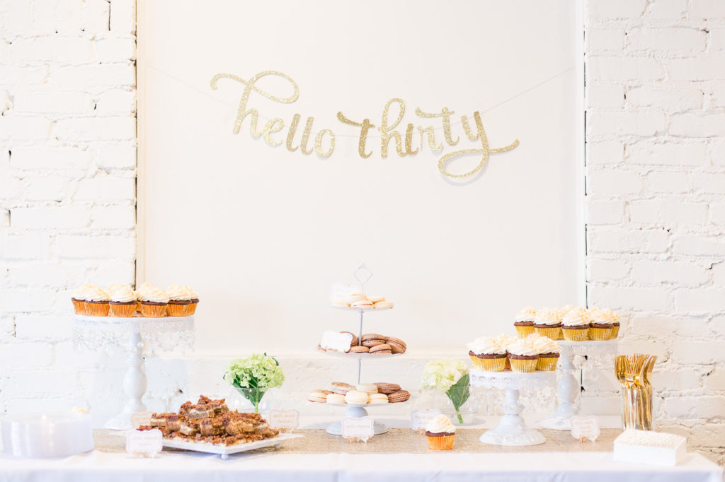 Are you turning 30 or planning a milestone 30th birthday party and need ideas or themes? We have a sweet and classy party for her complete with gold decorations, a photo booth and a dessert table to inspire your event! #30thbirthday #30th #partyideas #birthday