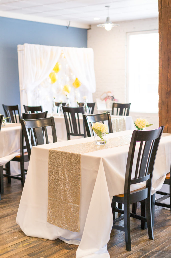 30th birthday table decor with gold table runners
