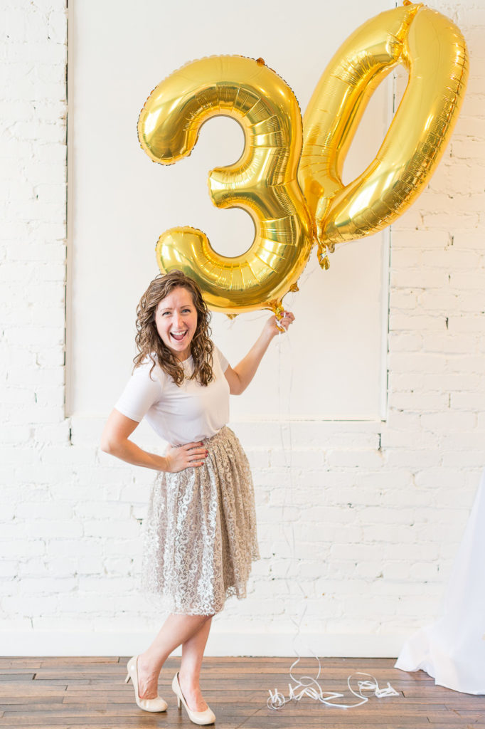 30th birthday photoshoot with giant 30 gold balloons