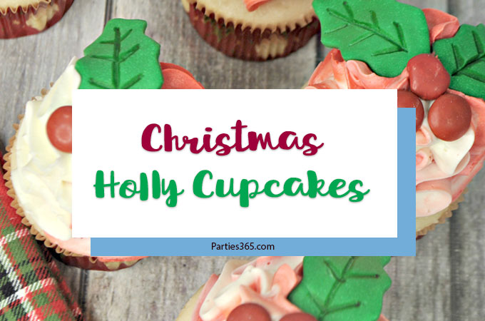 Looking for Christmas Cupcake ideas for the holidays? Our Holly Cupcake Recipe is a fancy dessert that's still easy to make! The cute fondant leaves and M&M berries really stand out on the candy cane inspired frosting. Click for the full recipe! #holidaybaking #holidayrecipes #Christmas