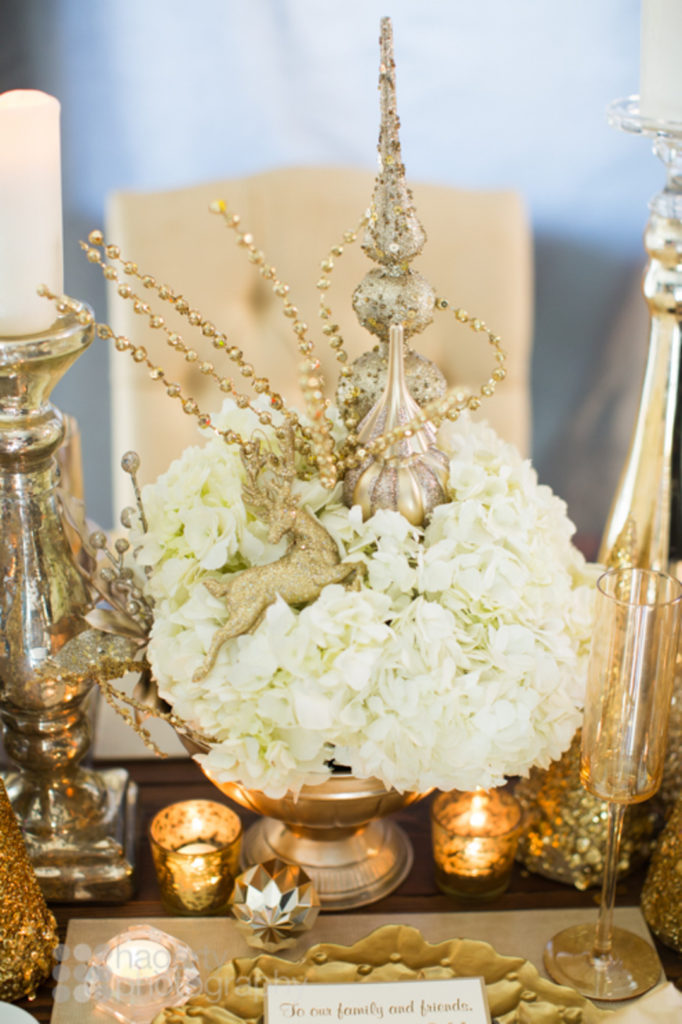 Looking for simple Christmas tablescape ideas for your holiday table? This elegant gold glitter table setting has a gorgeous centerpiece and would be the perfect table decoration for your party or dinner! Click for all the details! #Christmasdecor #holidaydecor #tablescape