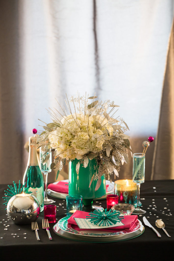 Looking for decor ideas for your New Year's Eve Party or New Years Brunch table? This modern, colorful tablescape and centerpiece with silver, pink and teal is a fun table setting that will wow your guests! #NewYears #tablescape #NewYearsEve