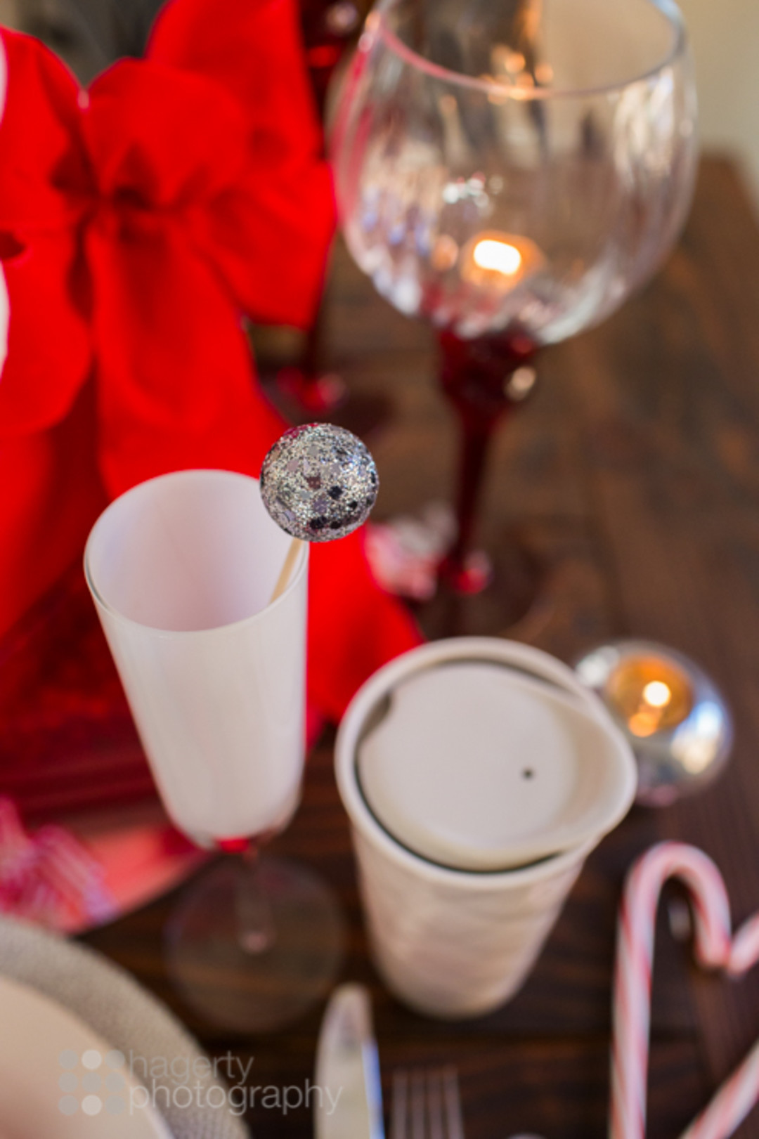 glitter cocktail stirrer in white champagne flute