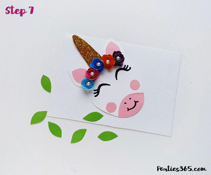 attaching paper flowers to unicorn craft