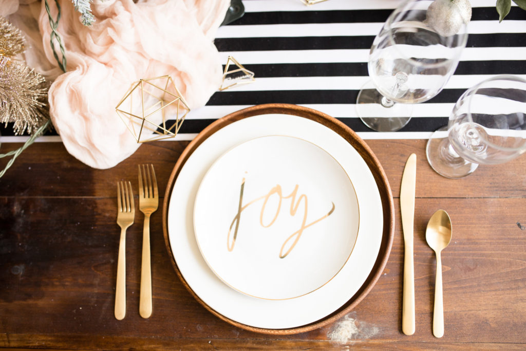 modern christmas table setting with gold joy plate