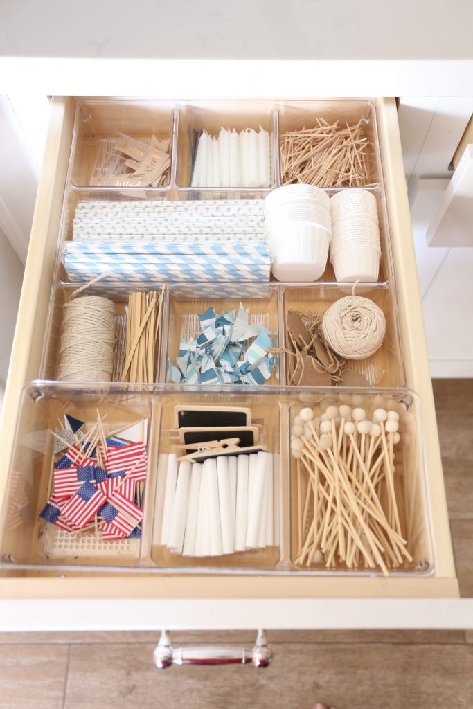 Need to calm the chaos of your party supply collection? We have some awesome storage and organization ideas and solutions from shelves to glass jars, boxes - all the products you need to get organized once and for all! #partysupplies #storage #organization #parties