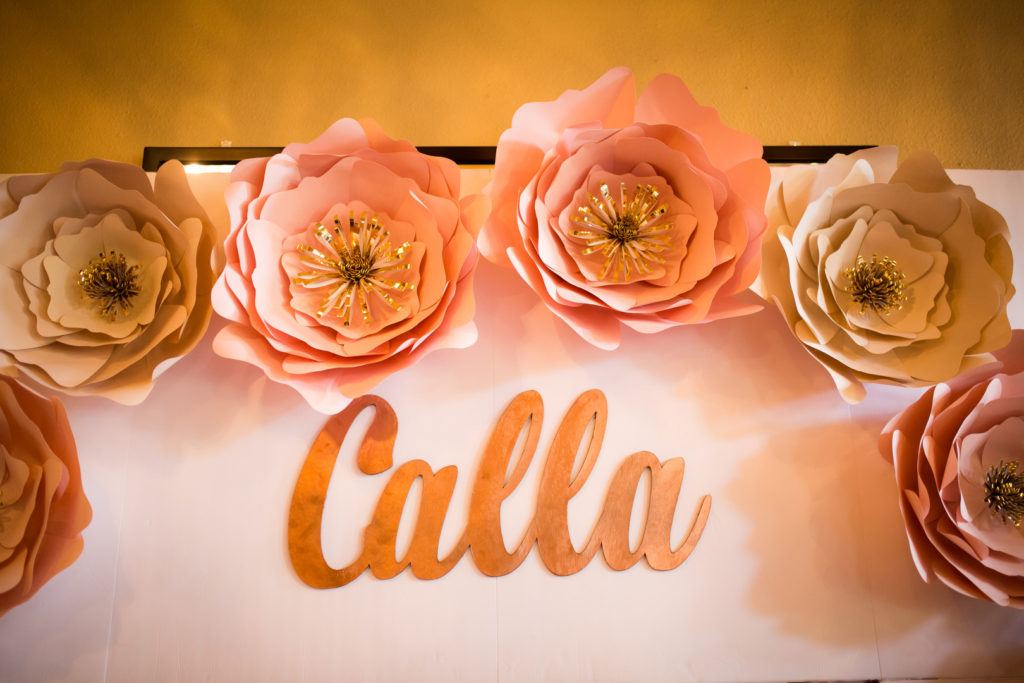 Quinceanera paper flowers and name display