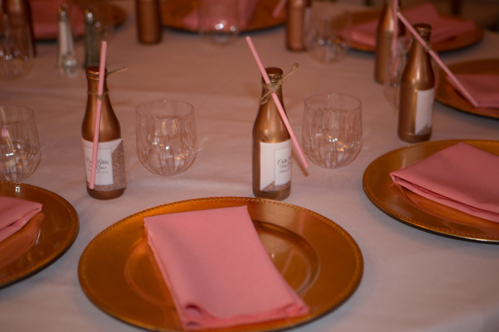 Quinceanera party table settings in pink