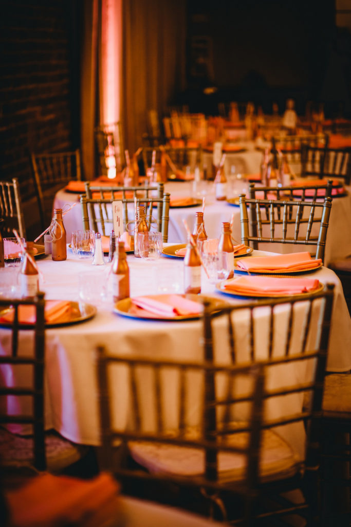 Quinceanera party tables with rose gold decorations