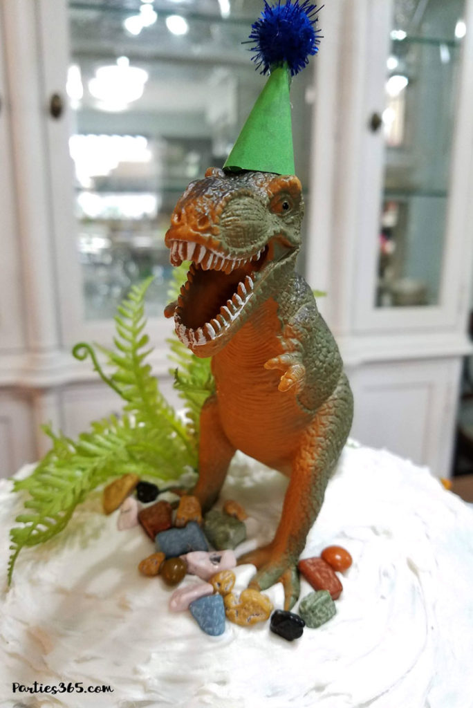 dinosaur with party hat cake topper