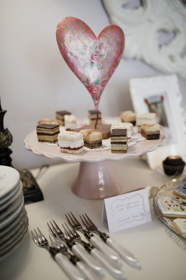 cake bites on a pink cake stand with heart for galentine's day tea party