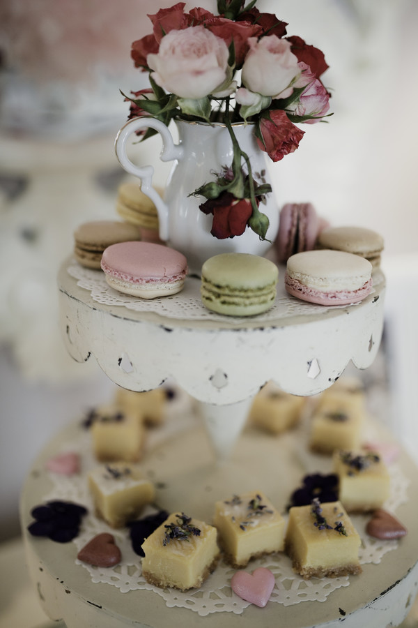 valentine's day tiered dessert tray with cheesecake bites and macarons