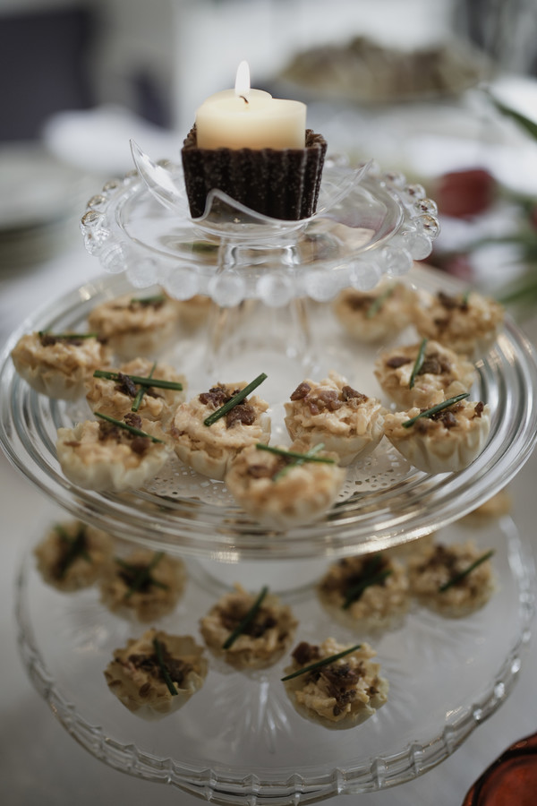 crab cakes on glass tiered serving tray at tea party