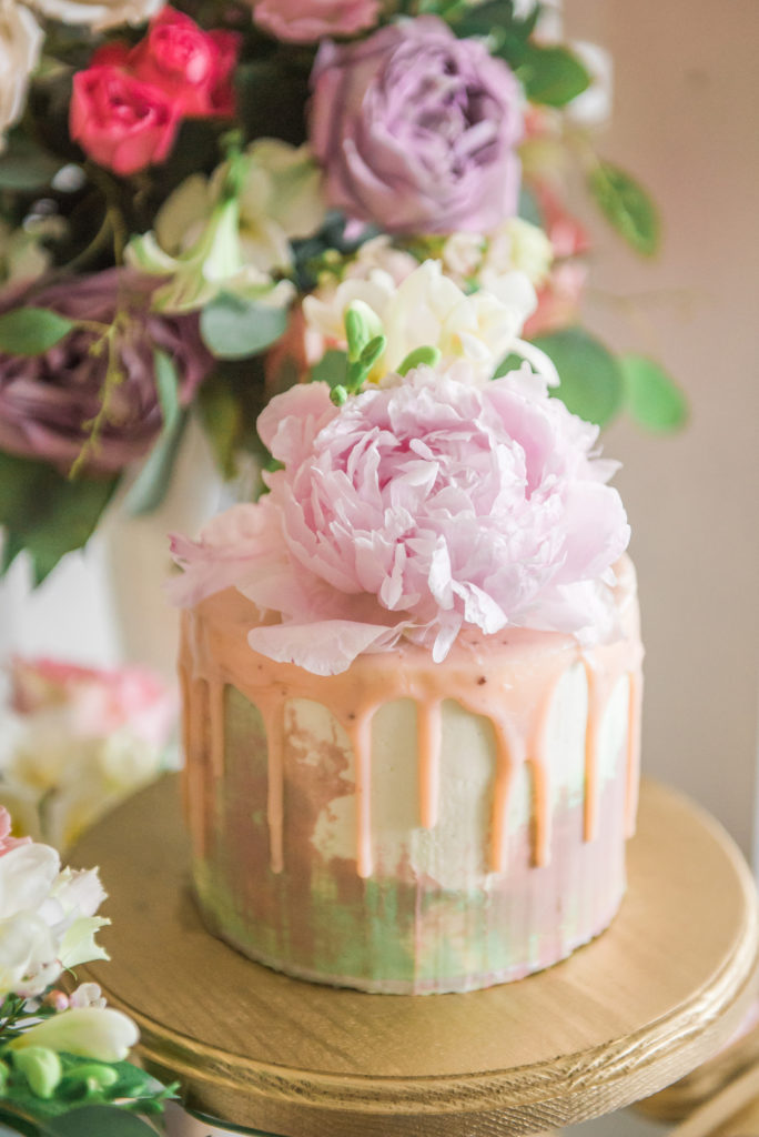 Spring and summer are wonderful times of year to throw a birthday party or shower and this dessert table is your inspiration for an elegant enchanted garden party! With so many ideas for decorations, food, flowers, desserts and cake, this indoor garden party is a must see! #gardenparty #spring #summer #partyideas
