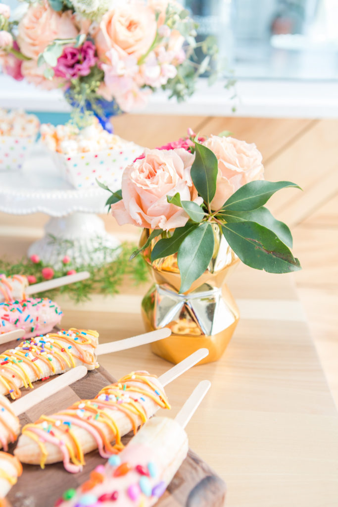 banana pops and flowers at spring girl's brithday party
