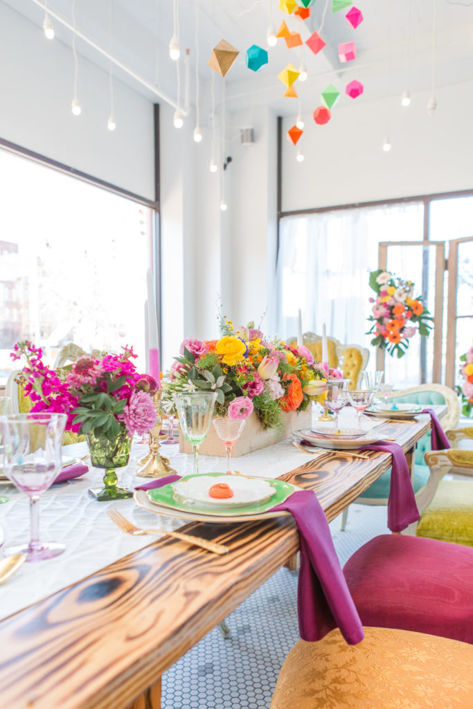 spring floral centerpiece and geometric mobile hanging from ceiling