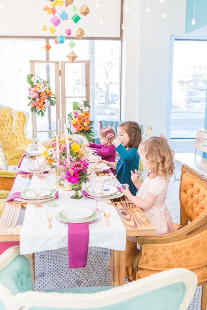 girls around party table for spring birthday party