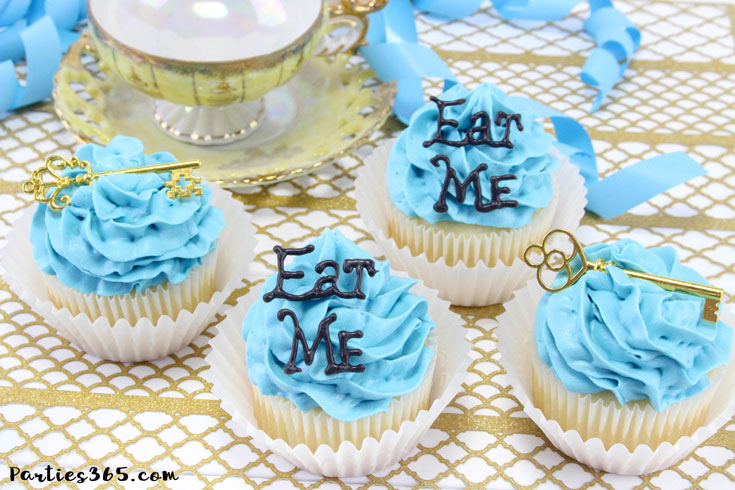 "These simple DIY cupcake toppers are perfect for your Alice in Wonderland theme party! The gold key and ""Eat Me"" decorations are easy ideas to make your party food whimsical and fun for all ages! #AliceinWonderland #cupcakes #TeaPartyIdeas"