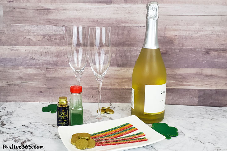 This festive St. Patrick's Day champagne cocktail is a fun and easy drink idea for your party! The simple recipe with sparkling wine, isn't green, but the gold under the rainbow will delight any St. Pattys leprechaun! #stpatricksday #champagne #cocktailrecipe #rainbow