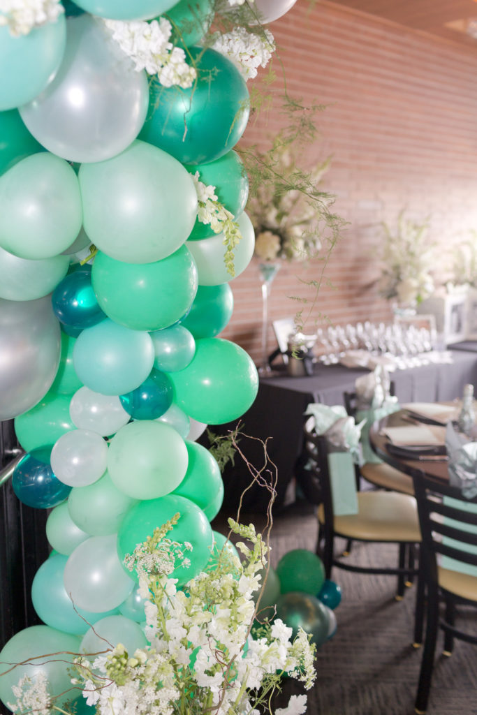 mint green balloon arch at bridal shower