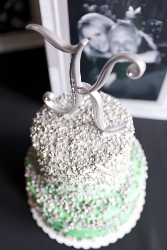 mint green and silver ombre bridal shower cake topped with the letter K cake topper